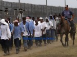 louisiana-prisoners-walking-from-farm-work-detail-600x449
