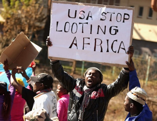 PRETORIA, SOUTH AFRICA - JUNE 28:  Anti-American demonstrators march through the streets while protesting against the official visit of U.S. President Barack Obama June 28, 2013 in Pretoria, South Africa. Organized by the Congress of South African Trade Unions, about 800 people marched through Pretoria to voice their opposition to Obama and U.S. policy in South Africa and around the world.  (Photo by Chip Somodevilla/Getty Images)