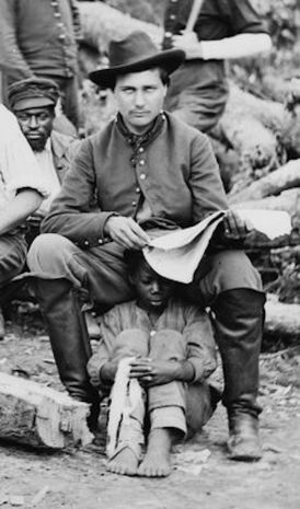 Union soldier with his personal Negus Child_ History dont repeat man does